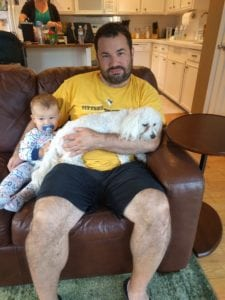 Matt, snuggling with our friends' sweet puppy, Lola. It's not all bad.