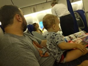 I am including this photo for one and only one reason, and that is because it looks like both my husband and my baby are scoping out that flight attendant's butt.